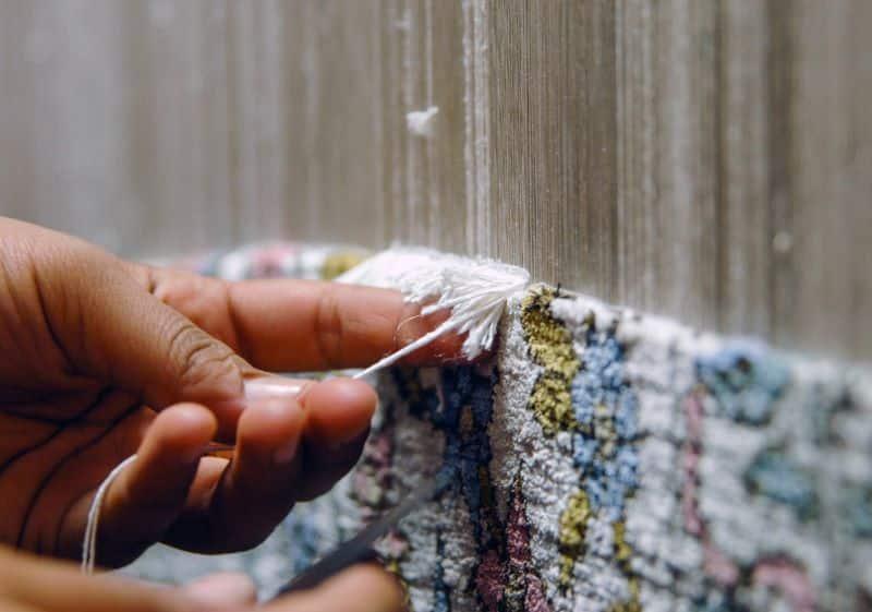 Hand Knotting A Fine Quality Rug Nazmiyal